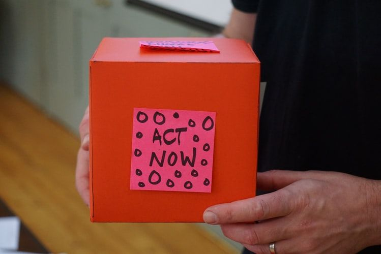 red box with a post it note on the side saying 'Act Now'
