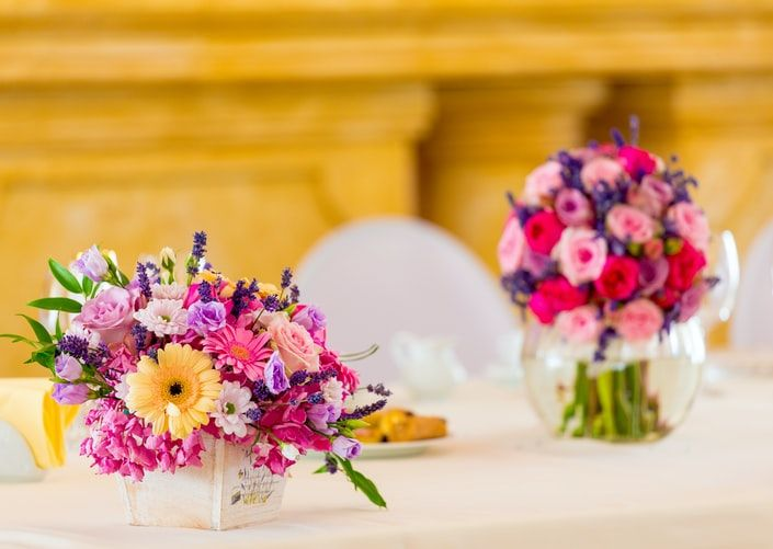 flower arrangements on a table in a venue