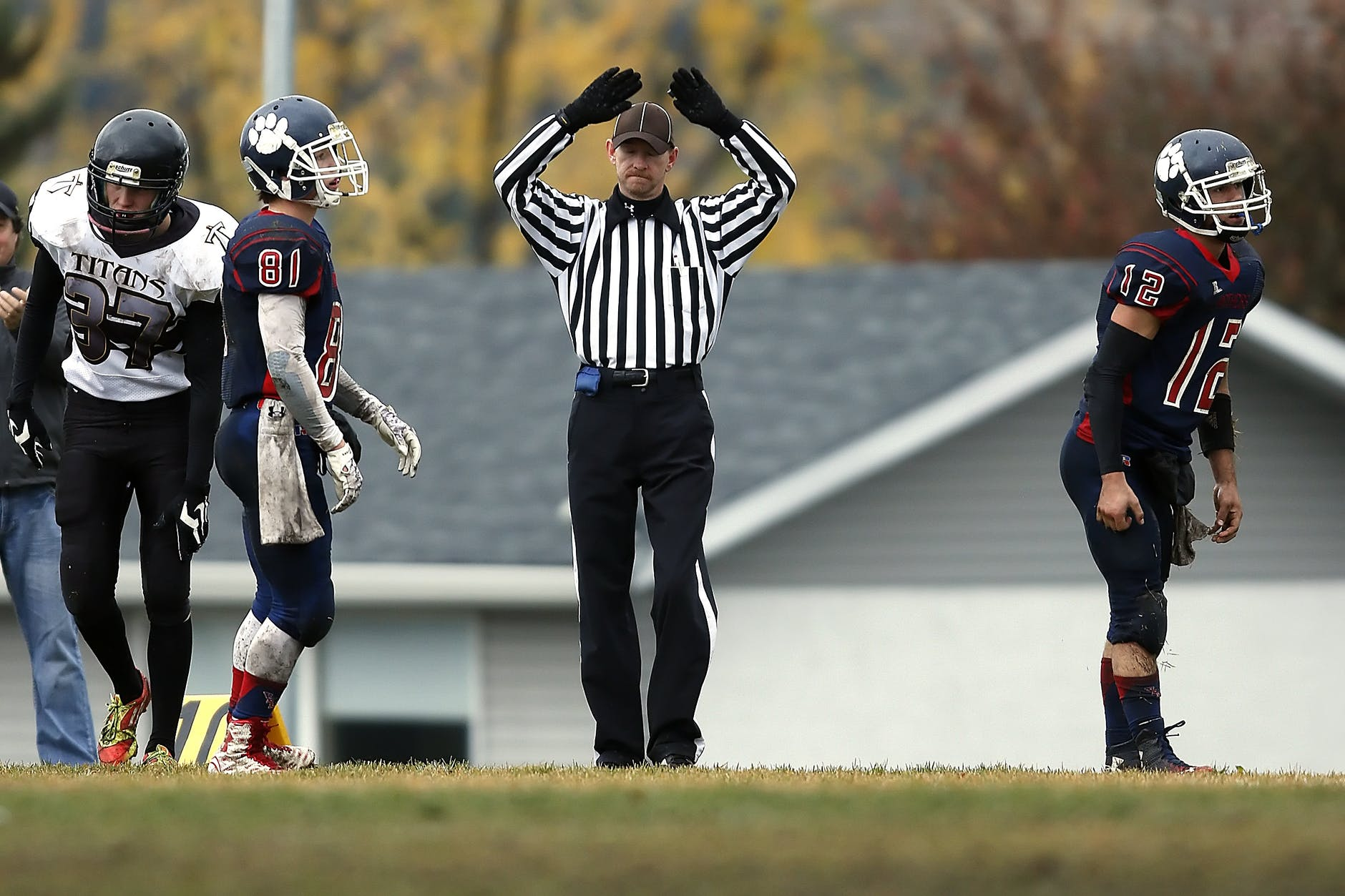 American football referee signaling time out