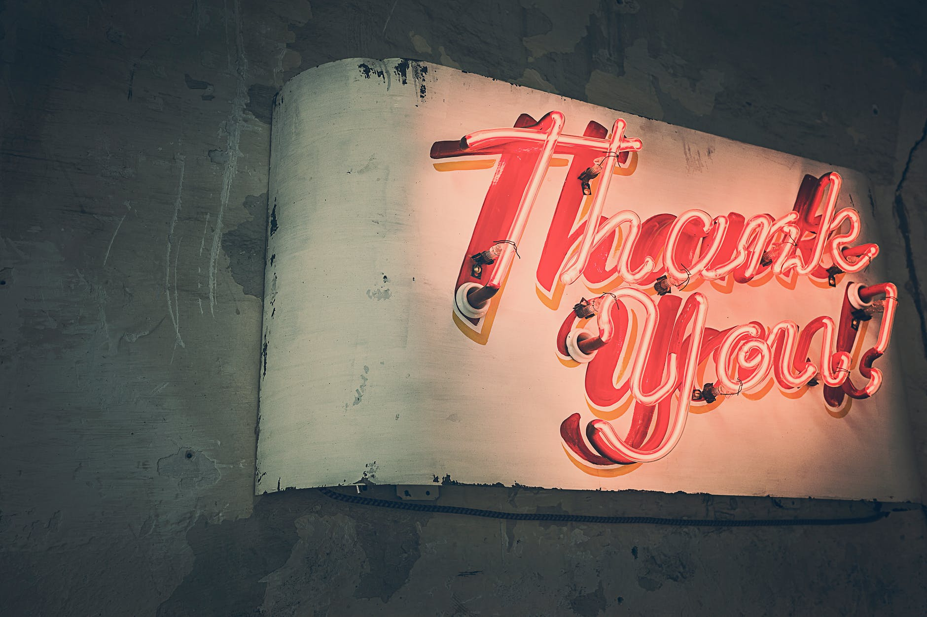 red neon sign saying Thank You