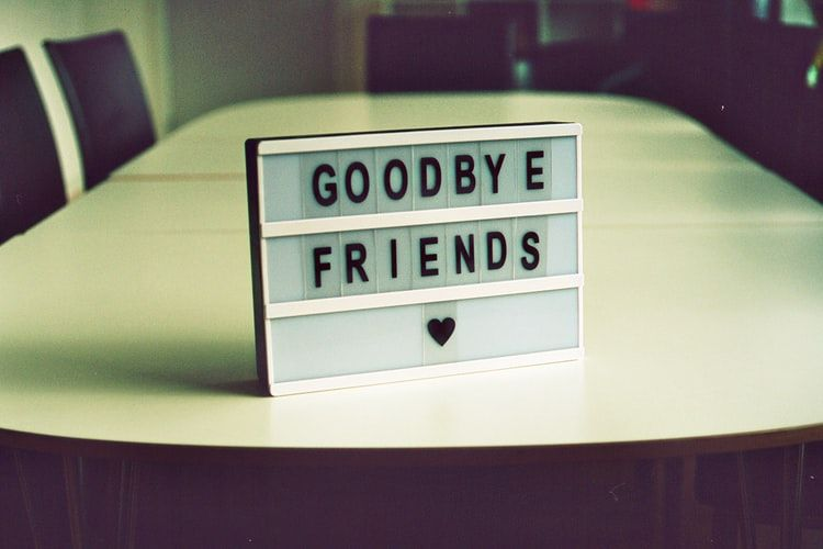 sign on a boardroom table saying 'Goodbye Friends'