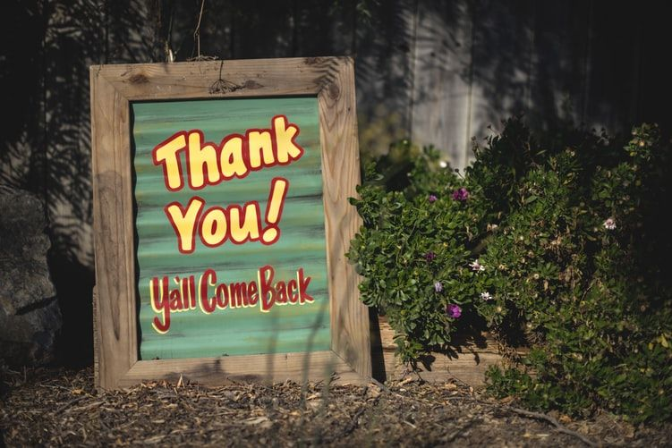 wooden sign saying Thank You Y'all Come back