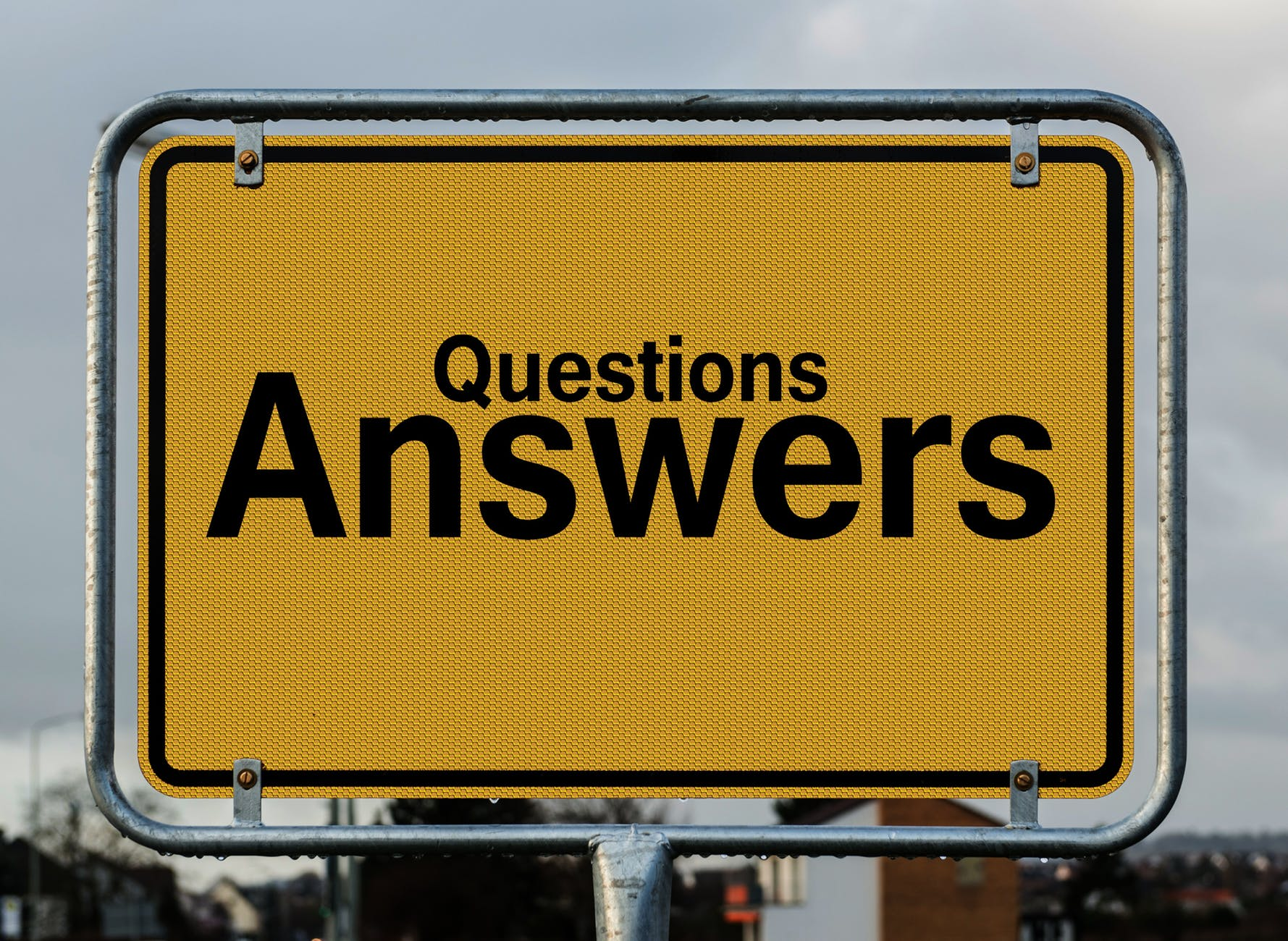 yellow sign saying Questions Answers