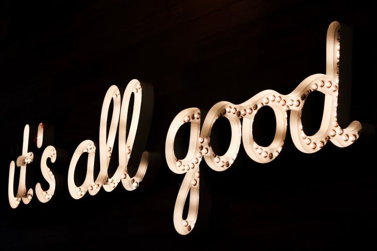 gold neon sign saying 'it's all good'